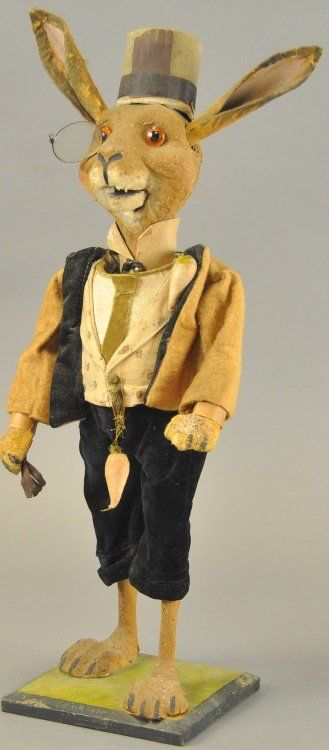 "Antique ""Nodding Rabbit"" Nattily Dressed Easter Figure, with glass eyes ,big ears,and a dangling carrot from his vest button."