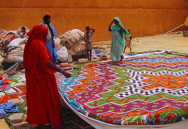 Africa | Tuareg women picking the fabric for a tent, Mauritania