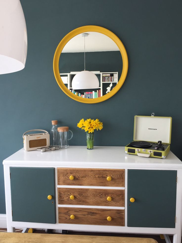 IKEA Stabekk mirror hack. Drinks cabinet upcycle. Lime Crosley record player. Cream Roberts radio. Daffodils. Contemporary dining room. Farrow and Ball Inchyra blue.