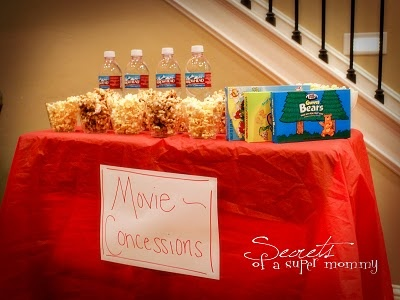 Movie Night Idea! I think I can make this cuter though. But i like this idea :) i would use cute popcorn holders and get glass soda pops like root bear coca cola and orange crush then get 4 big canisters to put 4 types of candies in each. and iron the table cloth and even maybe put a popcorn machine right smack in the middle!