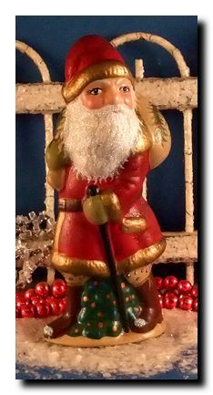 Santa on a Delivery  SD-02  5 1/2 inches tall  Santa is on a delivery to some lucky boy or girl. Oh the magic! What a wonderful face, almost child-like, looks likehe has a secret!