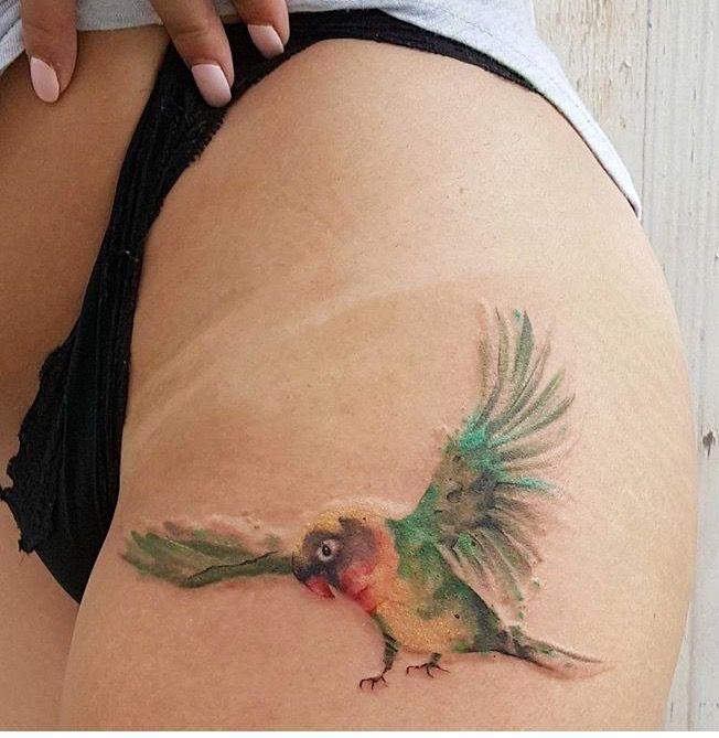 Jemka watercolor parrot tattoo
