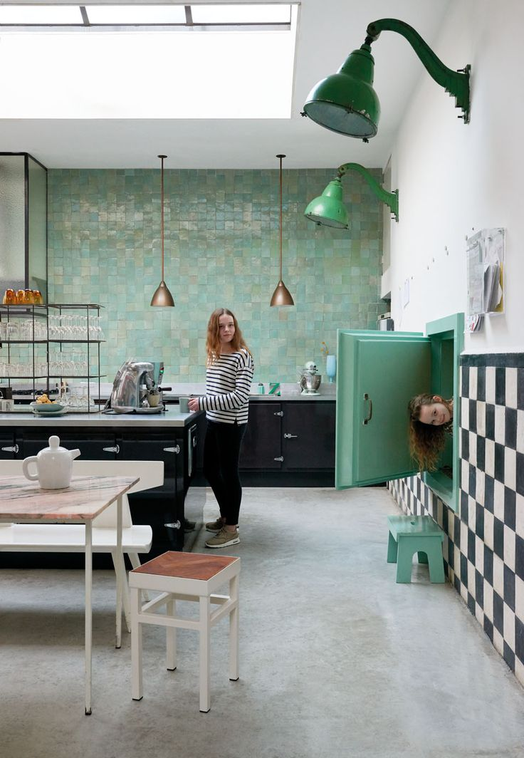 Green & black kitchen with a skylight in a unique family home in a former…
