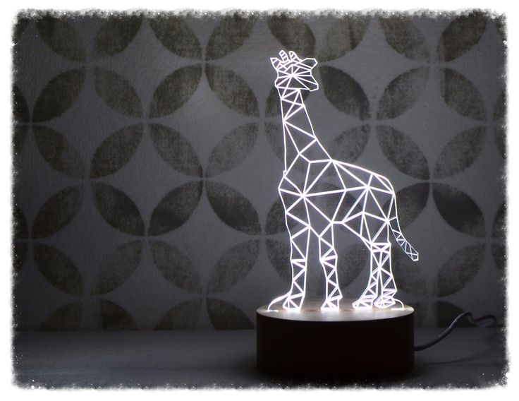 This stunning giraffe LED lamp is perfect as a feature light for any room. With a stylish beech timber base, it fits perfectly in a modern home.