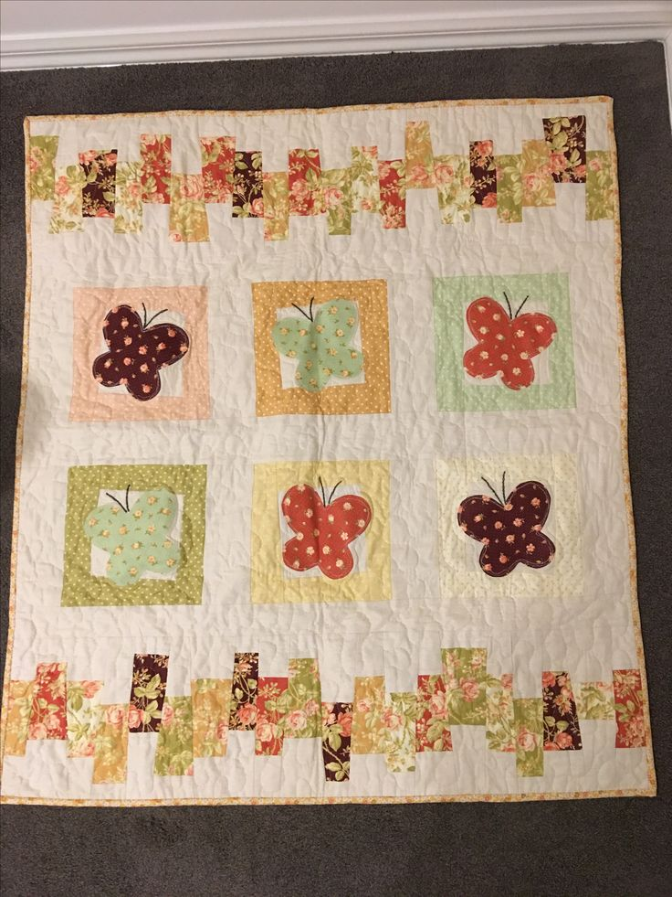 Butterfly cot quilt in warm florals for Florence Anne.
