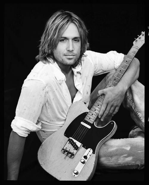 Keith Urban- mine and my husband's favorite country musician of today. This man is one talented musical explosion! He has some serious guitar skills. I started liking him in high school and I saw him in concert 2 years ago for Chuck's bday! :) This board is for all #CountryMusic Lovers who dig cool stuff that other fans could appreciate. Feel free to Post or Comment and Share this Pin! http://brandurband.com/bubsite/country-reviews #BUBLive #BrandUrBand