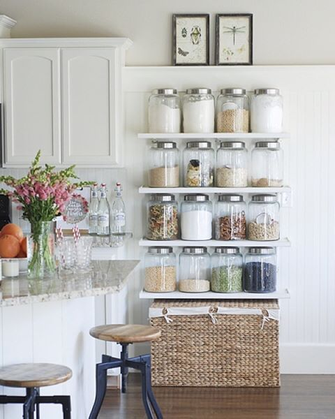 Still one of my very favorite home organization DIY projects- jar shelves in our kitchen which store our most used everyday staples. It actually doubled our pantry space and we use this more than we use our actual pantry! And yes they are safe with my littles. If you read the tutorial you will see how. They actually don't touch them anyway :). Thank you @eighteen25girls for sharing too!  For the tutorial and details, search the blog for jar shelves tutorial. Tap for sources.