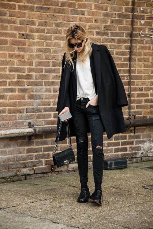 Ripped skinny jeans. Black winter coat. Chanel Boy bag. #rasspstyle #StreetStyle http://www.superrassspy.com/