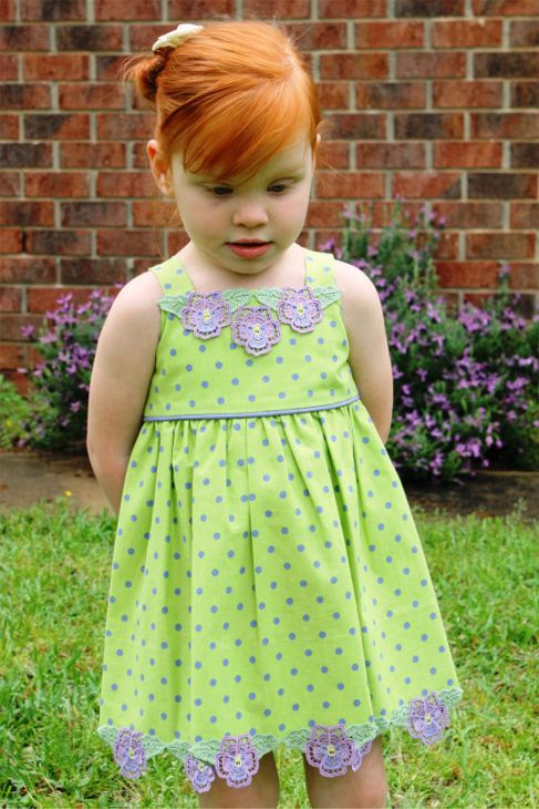 Free standing lace pansies on a little girls cotton dress