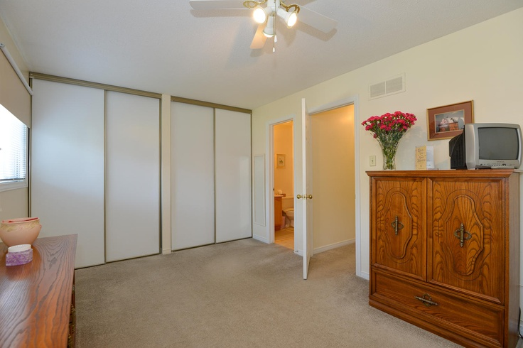 The master bedroom is huge at 19 feet across, and boasts his and hers closets with a full ensuite bathroom.