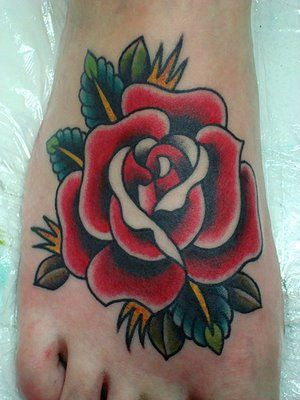 I just want a traditional rose foot tattoo with a ribbon over it that says dad instead of mum.. ♥