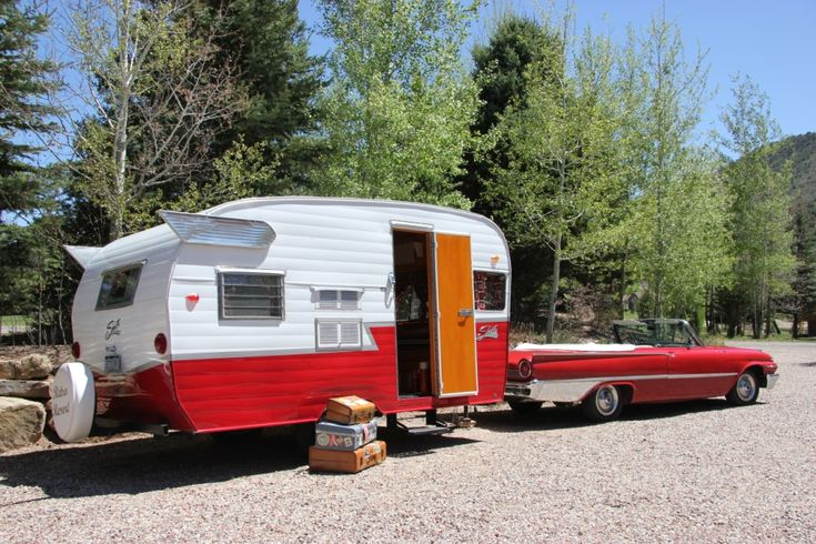 vintage travel trailers for sale retro road trip with a vintage travel trailer towed by a. Black Bedroom Furniture Sets. Home Design Ideas