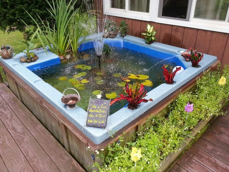 Upcycled broken hot tub into a fish pond our best tips for Garden pool from bathtub