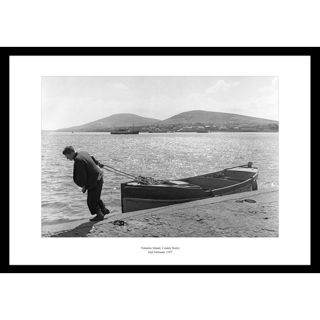 This stunning print caputes the beauty of Valentia Island in just one black and white photo. This photo shows a man pulling his boat from the water after what is presumed to be a hard days fishing.