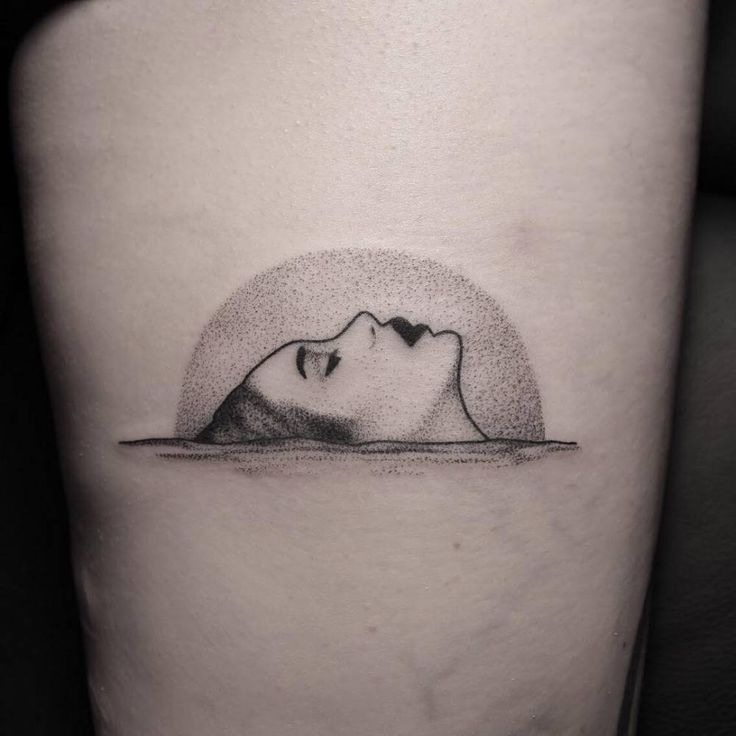 Dotwork style woman on the water tattoo.
