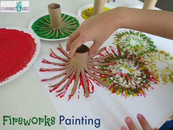 Painting fireworks with paper towel rolls.