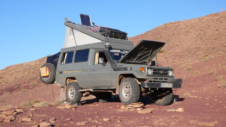 """Ruedi Fritsch renovated and well equiped Toyota Land Cruiser HZJ 75, 1999. A Troopy named """"Mulle"""" with 4.2 l turbodiesel and pop-up rooftent from http://toms-worldcruiser.com. Pictured here at the Atlas Mountains in Marocko. More images can be found here: http://picasaweb.google.com/ruedi.fritsch/Mulle?authkey=Gv1sRgCJr-3bme3OirkwE#5569528790304657426"""