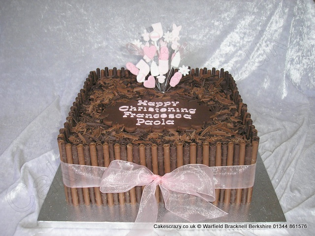 Square chocolate roll and crumbled chocolate flake christening cake