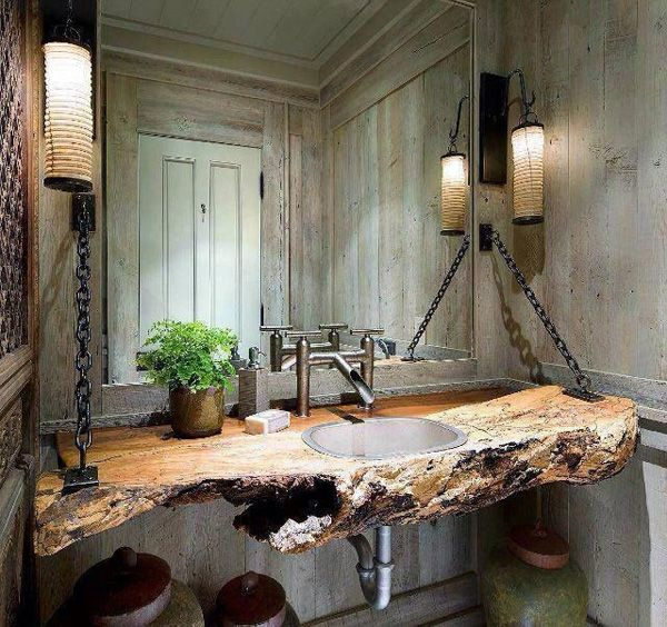Whitewashed barnwood paneling, full mirror, vintage rice paper lights, chain and petrified wood suspended sink, wild modern faucet