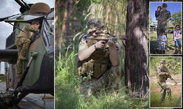 Prince Harry goes on patrol Down Under: Fantastic photographs show the royal getting to grips with a chopper, stalking through the jungle... and even paying a surprise visit to some children