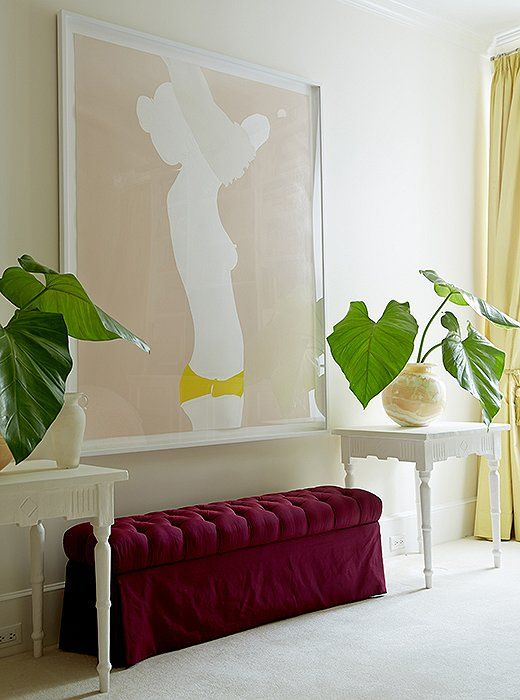 "pastel pink with jewel tones // ""I love the cheeky subject matter and her use of color,"" says Amanda of the nude painting by Natasha Law, which presides over her bedroom above a custom-made bench and tables by Brooklyn plaster artist Stephen Antonson."