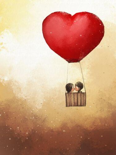 Pareja dándose un beso en un globo