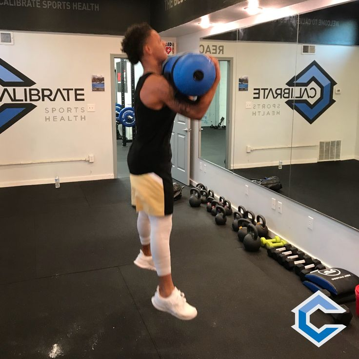 Jump Squats with a slosh bags bring a whole new level of difficulty to this movement.  #littleton #littletoncolorado #downtownlittleton #littletonfitness #exploreltn #teamcalibr8 #fitfam #squats #fitness #squat #gym #sloshbag #fit #gymlife #training #muscle #stabilitytraining