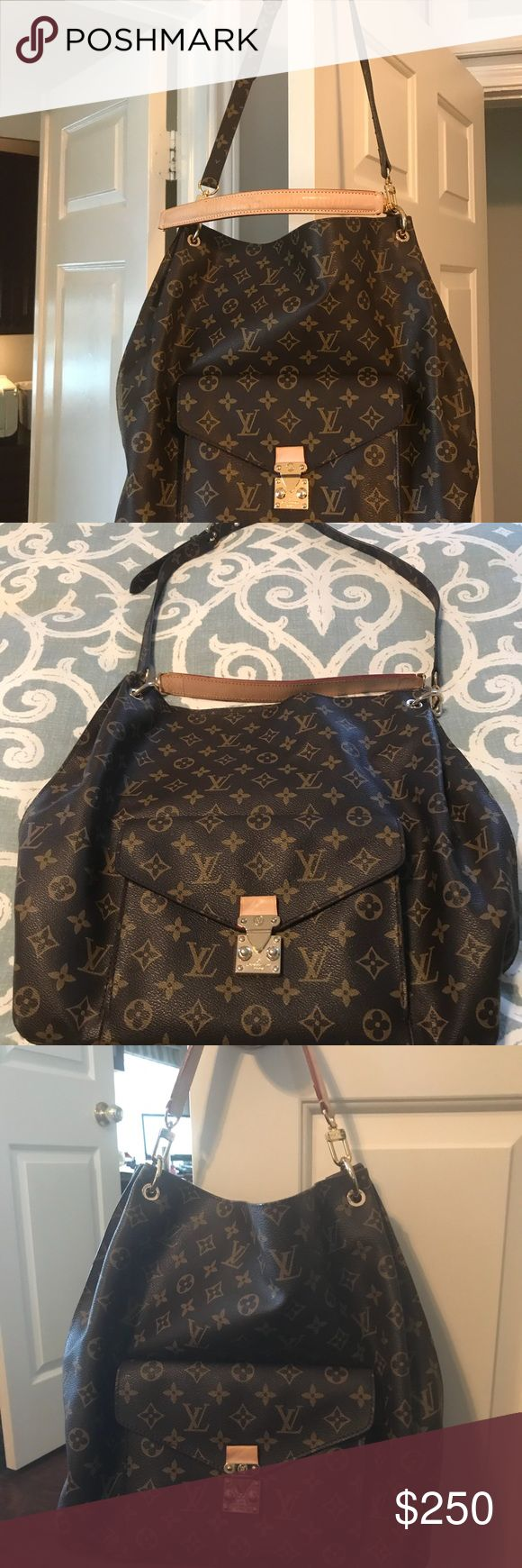 """Louis Vuitton Large Tote/ Hobo Gorgeous Louis Vuitton large hobo/tote. I bought this bag on eBay two years ago. I have the dust bag and care booklet from Louis Vuitton, but I cannot swear to it's authenticity. However, I have seen real Louis Vuitton purses, and defy anyone to say it isn't authentic. Have used it several times, but found it to be larger than I was comfortable with. in perfect condition, no cracks in the leather, no stains or wear on the interior. Dimensions are 14""""x14""""x5""""…"""