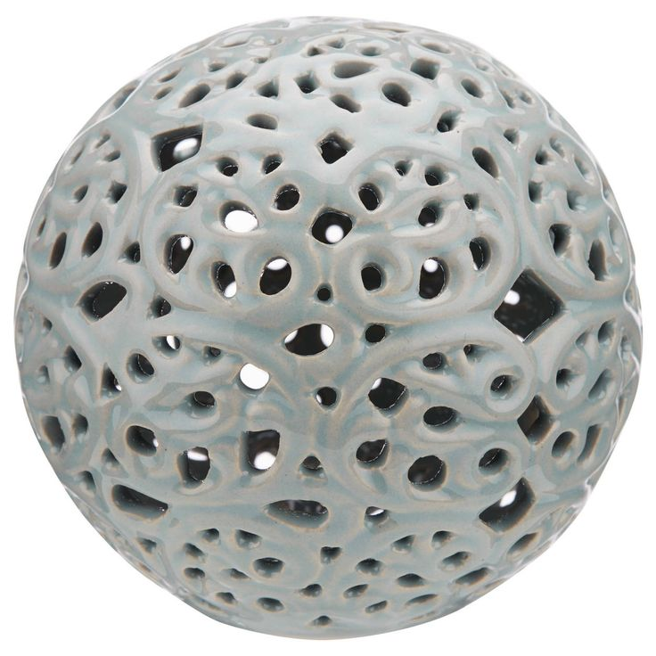 Looking to add a touch of modern style to your space? This round ceramic ball will do just that! Featuring a cool cutout design, this sphere has loads of visual appeal. The perfect piece for so many different styles of interiors, it's a sure-fire way to give your home an instant update. Display it in a bowl with other decorative objects or place it on top of a stack of books to create a quick and easy vignette. Any way you display it, you're sure to make a cool impact.