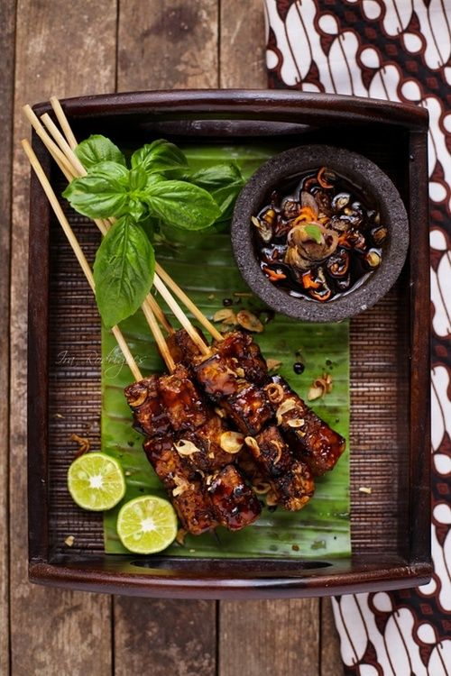 Sate Tempe - Tempe Satay. Tempe is fermented soy in a cake form, usually sliced thinly and served with spicy sweet sauce, considered as healthy traditional food in the country