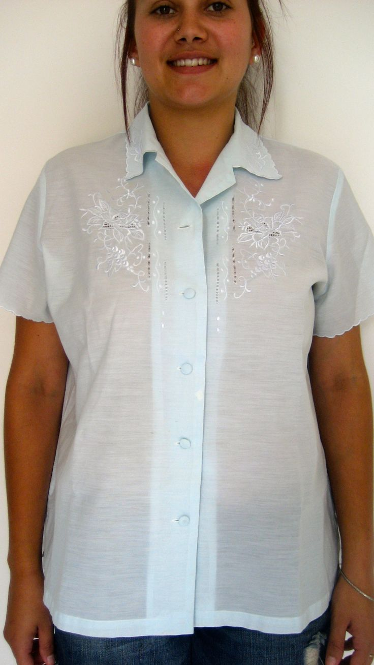 Tag says XL AU $25 L: 64cm B: 108cm   Sky blue colour vintage top with gorgeous floral stitching on the front and collar with a full button up front and this top is semi sheer.