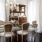 dining rooms - gray walls gray cane back French dining chairs gray glass-top dining table espresso wood floors white silk drapes antique buffet hutch crystal chandelier