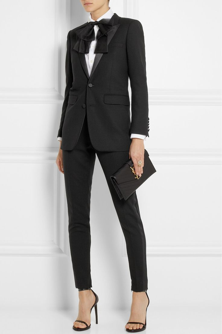 Saint Laurent pioneered the iconic 'Le Smoking' tuxedo suit in 1966. These slim-leg satin-trimmed pants pay homage to the look. A sleek alternative to a cocktail dress or gown.