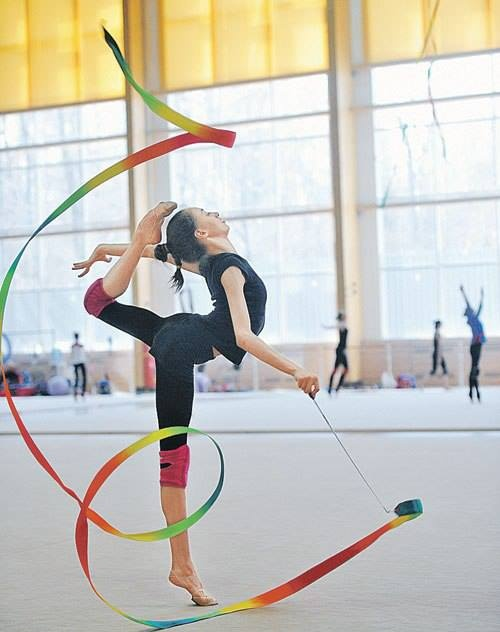 Rhythmic gymnastics.... man, I really really want to do rhythmic gymnastics.!!!!!!!!! Its so much more graceful, beautiful, awesome, etc.. I do artistic gymnastics. Which is you know, beam, bar, floor and vault.:) :(