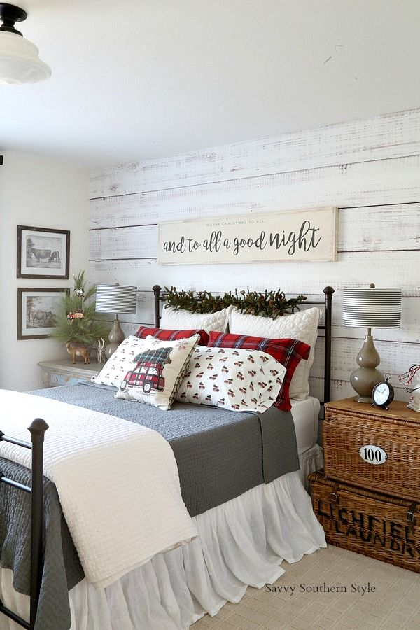 Christmas bedroom styling - gray flannel sheets, red plaid pillowcases, tabletop trees, and a glass bowl with old ornaments.