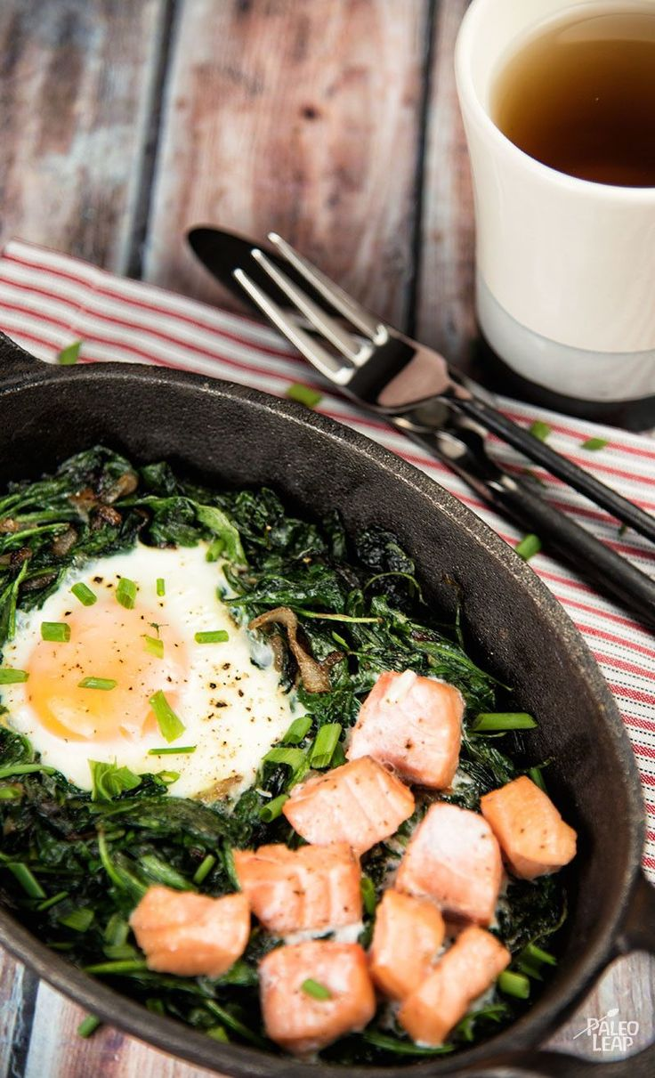 Baked Eggs With Spinach And Smoked Salmon - A super-easy but strikingly beautiful way to combine three nutritious Paleo staples in one breakfast. #Paleo #Glutenfree