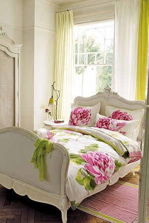 A delightful floral bedding with large scale print of peonies on a fresh pure cotton white ground with a smart coordinating striped reverse.