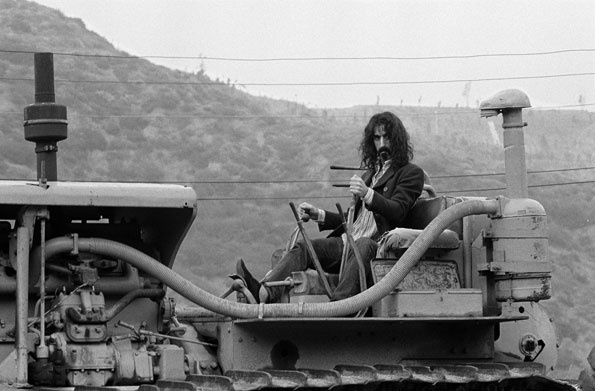 Frank Zappa posing on a tractor / California, 1968 / photo by Baron Wolman | Rolling Stone
