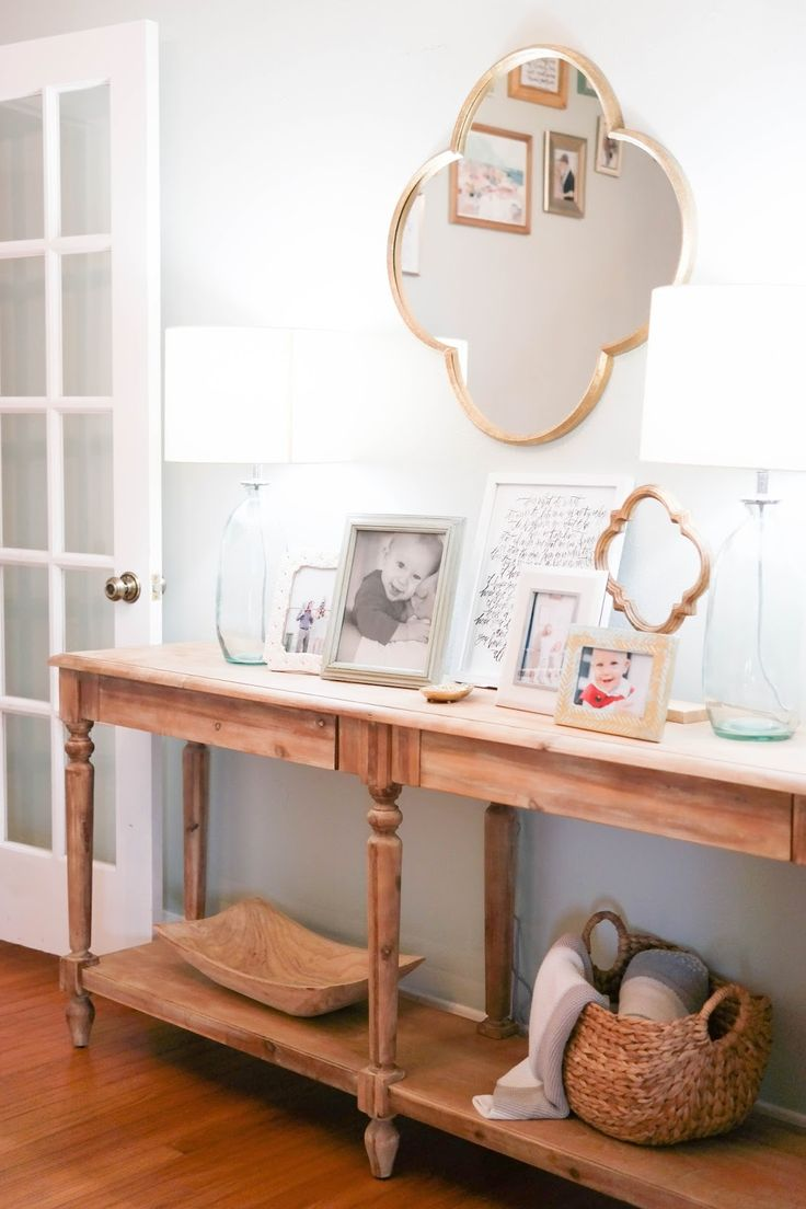 {wood clover on a stand from target //  everett foyer table from world market //  the lamps // quatrefoil mirror //...