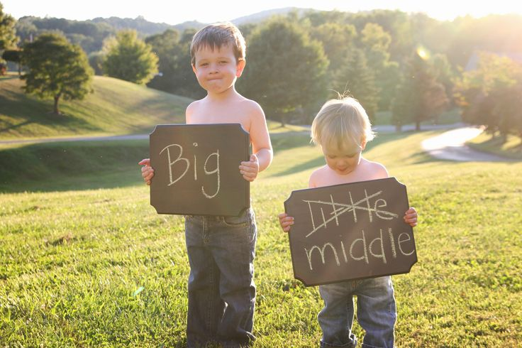 Pregnancy announcement.  Big brothers announcing baby #3!