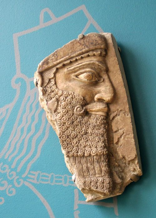 Gypsum bas-relief head of King Ashurnasirpal II from the Northwest Palace (room B, panel 4) in the Assyrian city of Nimrud. The relief dates back to 875-860 BCE. Bowdoin College Museum of Art,