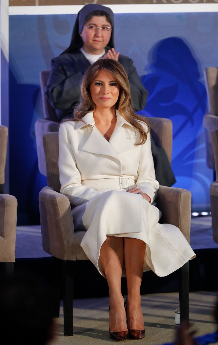 Trump spoke to a packed room sporting the design from The Row, which echoed the military-inspired topper from Balmain that the First Lady wore to cast her ballot. The dress also recalled the Karl Lagerfeld–designed suit she wore to meet Sara Netanyahu. As has become the First Lady's signature style maneuver, Trump accessorized with her Graff engagement ring and Christian Louboutin python stilettos.