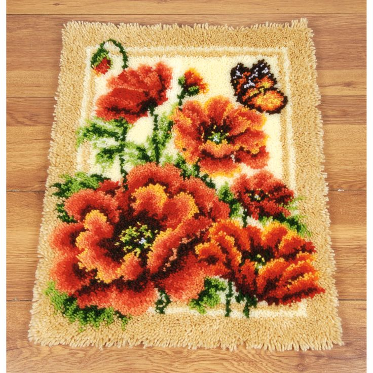 Poppies & Buttefly Bold, beautiful poppies make an eye-catching wall hanging or floor rug. Your Latch Hook rug kit includes design hand-painted on 4.5-mesh canvas, pre-cut acrylic yarn, latch hook tool and instructions. 47 x 62 cm Poppies & ButterflySKU: 41872