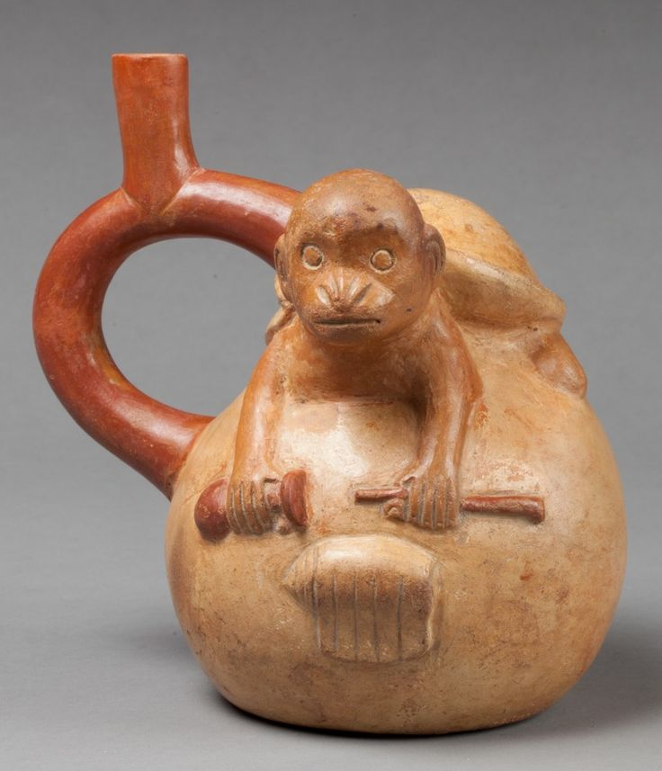 Moche monkey emerging from a conch shell holding a poporo