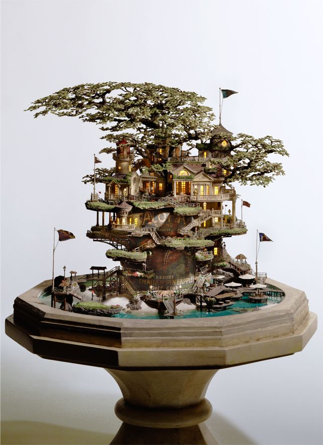 Artist transforms bonsai trees and empty cans into insane Lilliputian cities. Courtesy io9.com