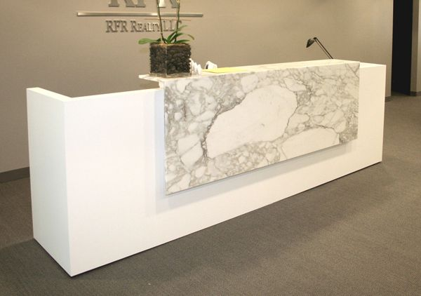 Custom reception desk. Simple form and materials to
