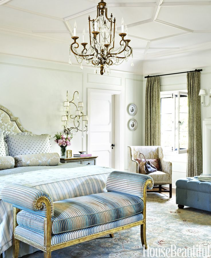 Benjamin Moore's Hint of Mint on the walls and the antique crystal sconce and chandelier make for a peaceful but sparkling bedroom. The custom bench is covered in Sheila Coombes's Nomad velvet.    - HouseBeautiful.com