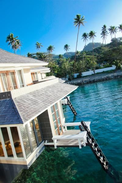 never have I stayed in a room that had glass floors over the water...and the waters of Fiji look really nice. take me there now!