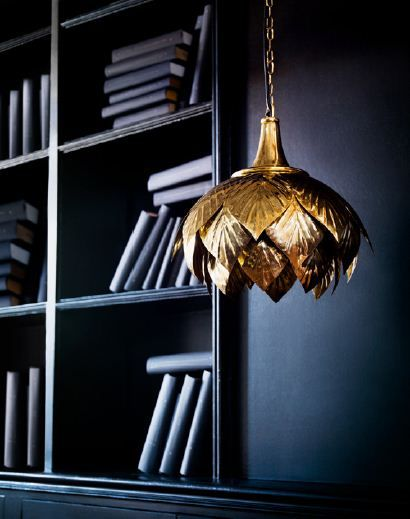 A standout gold pendant light for the living room is inspired by the Art Deco trend.