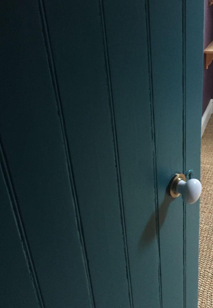 porcelain door knob with antique brass backplate on. Black Bedroom Furniture Sets. Home Design Ideas